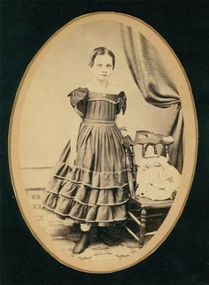 """Little girl and her china doll, 1865. """"Florence McCollum, taken 1865 at the age of 9"""""""