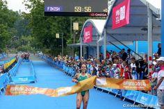 Australian Brittany Dutton crosses the triathlon finish line.
