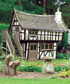 This is the perfect example of a storybook playhouse! Russell Bowlby, owner of Flights of Fantasy, designs children's playhouses and theme play equipment. The two storey, crooked timber framed Tudor Cottage...