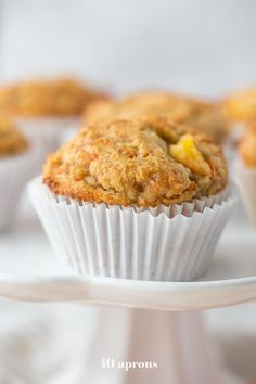 These peach ginger paleo muffins are moist and tender, and they don't taste like they're paleo! Gluten-free, grain-free, dairy-free, refined sugar-free.