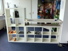 Ikea Hack reception counter (or stand up desk): 2 Expedit 2x4 bookcases, 1 tabletop and 6 Capita legs