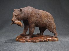 One For The Road Wood Sculpture of Bear with Fish by ArtistinWood, $1200.00