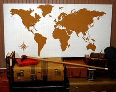 This corkboard map is genius! Saw something similar - paint a globe with colored chalkboard paint. Fun way to record travels!