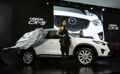 Mazda plans to tailor its crossover SUV for the Chinese market in a push to revive sales. Chinese Market, Mazda, Baby Strollers, Japanese, Crossover, Baby Prams, Audio Crossover, Japanese Language, Strollers