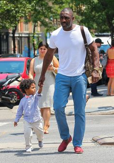 52114250 Actor Idris Elba and his son Winston are spotted out with a friend in New York City, New York on July Winston got a little tired of walking so his daddy gave him a ride on his shoulders. FameFlynet, Inc - Beverly Hills, CA, USA - Black Is Beautiful, Gorgeous Men, Beautiful Family, Idris Alba, Actor Idris, Black Fathers, Handsome Black Men, Raining Men, Men's Wardrobe