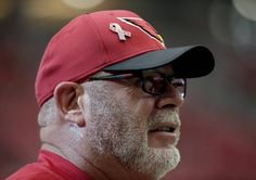 A 9/11 memorial pin is seen on the cap of Arizona Cardinals head coach Bruce Arians prior to an NFL football game against the New England Patriots, Sunday, Sept. 11, 2016, in Glendale, Ariz. (AP Photo/Rick Scuteri)
