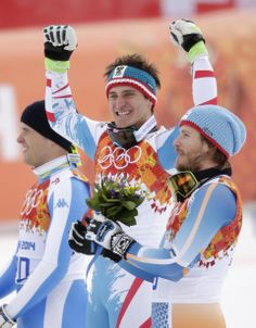 Mayer beats Miller, Svindal in Olympic downhill - Men's downhill medalists from left, Italy's Christof Innerhofer, silver, Austria's Matthias Mayer, gold, and Norway's Kjetil Jansrud, bronze, participate in a flower ceremony at the Sochi 2014 Winter Olympics, Sunday, Feb. 9, 2014, in Krasnaya Polyana, Russia. (AP Photo/Jae C. Hong)