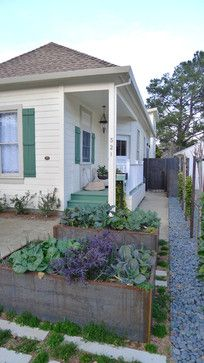 Edible garden in raised beds - White farmhouse - Home exterior with pastel / muted greens, browns, and purples - By: BaDesign in Oakland, California