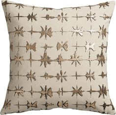 star quality.  Screen-printed on a natural field of linen/cotton, gold foil starbursts radiate a flash of modern glam in an organic grid.  Dark undertones create depth, emphasizing the freeform effect.  Reverses to slubby chambray blue 100% cotton.  Do the math: CB2 low prices include a pillow insert in your choice of plush feather or lofty down-alternative (a rare thing indeed).