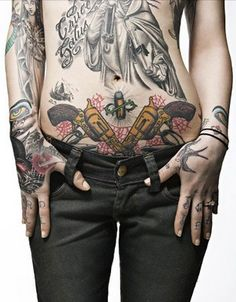 This is absolutely sexy..black and gray...with a tinge of color.  #tattoos