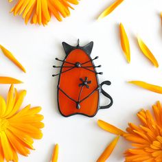 Little funny cat made ​​from bright orange stained glass and copper in Tiffany technique.  Great handmade gift for animal lovers!   Can be used like decor or pendant. #artkvarta #cat #catdecor #catnecklace #autumn #fall #orange #bright #funny #animals #ornament #giftidea #tasty #floral #flower #orangeflower