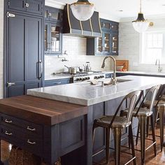 Love the moody colors and cool range hood coordinating with the brass and matte black Brighton pendants. Big Kitchen, Kitchen Decor, Kitchen Design, Kitchen Pendants, Kitchen Backsplash, Blue Cabinets, Kitchen Island Lighting, Butcher Block Countertops, Antique Hardware
