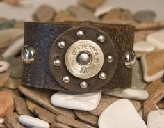 Jewelry / Leather Cuff Shotgun Shell studded wrist cuff by MichelleVerbeeck Shotgun Shell Crafts, Shotgun Shell Jewelry, Shotgun Shells, Leather Cuffs, Leather Jewelry, Leather And Lace, Leather Bracelets, Bullet Art, Bullet Shell