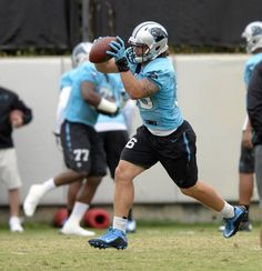 Carolina Panthers' A.J. Klein (56) catches a pass during a drill at the team's practice facility on Thursday, September 24, 2015.