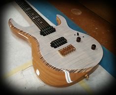 Kiesel Guitars Carvin Guitars A6 (Aries) translucent white over flamed maple top and deep body binding effect on bevel