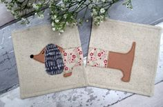 Sausage Dog With Pink Flower Jumper Coasters - Set Of 2 - Appliqué Linen Fabric by The Cornish Coaster Company on Gourmly