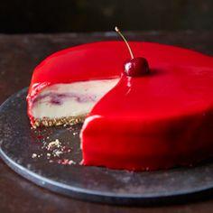 White chocolate and cherry cheesecake with a red mirror glaze - Sainsbury's Magazine