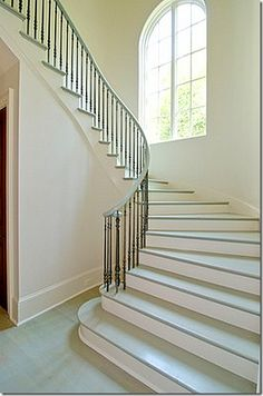 Simple wrought iron and wood banister and railing