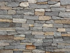 Ledgestone Thin Veneer consists of a wide range of colors including gray, white, tan, pink, and black. The Ledgestone pattern of stone veneer consists of thin strips of natural stone. Brick Siding, Stone Siding, Stone Facade, Stone Masonry, Brick And Stone, Stone Walls, How To Install Pavers, Brick Face, Thin Stone Veneer