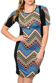 17c1dcc1bb7 This sassy and sophisticated short sleeve dress features vibrant zig zag  color pattern
