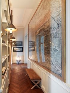Gorgeous hallway library with chevron patterned wood floors!