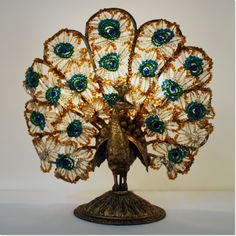 This peacock lamp in our store is just overflowing with detail and elegant craftmanship