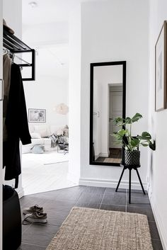 Simple black and white entryway with a natural touch from the beige rug.