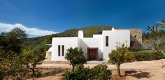 We take a peek into a stunning home in north Ibiza designed by TG Studio. Far from the bustle of the Ibiza strip sits this beautiful whitewashed villa. Adobe House, Mediterranean Style Homes, Villa, Spanish House, Elegant Homes, My Dream Home, House Design, House Styles, Bikini