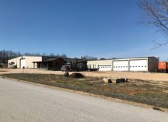 Commercial/Industrial Buildings on 40 acres in Cabool, Missouri. 2 red iron framed metal buildings plus a log cabin with a 20x21 office space. The first metal building is 100x120 with an 8x31 compressor lean-to. There are 2 rest rooms and an employee break area in this building as well as an office area. The second building is 40x100 for a combined total of 16,780 under roof. In addition, there is also a 48x54 covered patio/storage area enclosed on 3 sides, built over concrete pad.