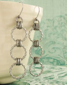 This Bracelet and Earring Kit will make a bracelet plus these earrings plus a SURPRISE! ~ Square Stainless Steel Twist of Fate Chainmaille - Unique On Edge Rings. $60.00, via Etsy.