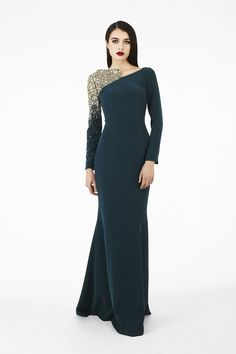 #evening gown #Georges Hobeika Great teal number with one black and white bedazzelled sleeve.
