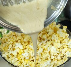 ooey gooey popcorn - Butter popcorn with marshmallow brown sugar buttery gooey sauce tossed into it.I might could eat popcorn this way. Salty Snacks, Yummy Snacks, Delicious Desserts, Snack Recipes, Dessert Recipes, Cooking Recipes, Yummy Food, Popcorn Snacks, Candy Recipes