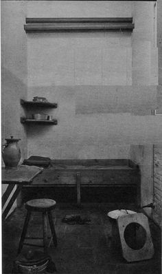 """Cel 601. Death row in the nazi prison in Scheveningen, The Netherlands. The prison was called """"the Orange Hotel"""". The bunk and some other objects to comfort the prisoners in their last hours."""
