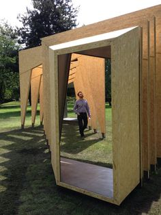 Visitors can stroll through free-standing wooden frames in this pavilion.