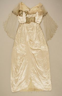 Dress, Evening.  House of Worth  (French, 1858–1956).  Date: 1914–16. Culture: French. Medium: silk, metallic thread, glass. Dimensions: Length: 54 1/4 in. (137.8 cm).