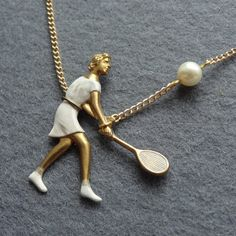 Smashing Tennis Player Necklace  - enamelled on vintage brass with pearl. Love this new design from a friend of mine. Good timing too before the Wimbledon