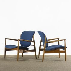 Lot 244: Finn Juhl. lounge chairs. 1958, teak, upholstery, enameled brass. 31 w x 28 d x 31½ h in. result: $8,125. estimate: $3,000–5,000. Signed with disc metal manufacturer's label to frame of each example: [France and Son Denmark].