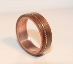 Here we have a hand made bentwood Walnut and Copper with an external twisted copper Inlay ring, the Inlay Its self Is off center, If youd