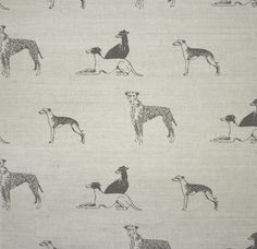 Long Dog Linen Fabric An untreated linen fabric featuring whippets, lurchers and greyhounds hand printed in steel grey.
