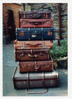 Suit cases Leather Old Stacked
