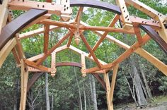 This timber frame compound joinery outdoor cooking porch - has it all dragon beams, hand carved pendants... With black walnut accents to boot!
