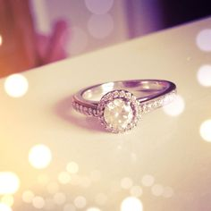 1920's Vintage Engagement ring....ok Joe....of the vintage STYLES I like this one best cuz it doesn't get overshadowed by the 'halo'.....plus its just gorgeous! :-) no more questions!!