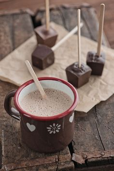 Food: Homemade Hot Chocolate on brown wood table By inaAvailable to license exclusively at Stocksy