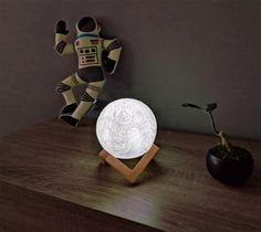 16 Moon and Astronaut Themed Gadgets To Help Celebrate The Moon Landing Anniversary - Decorazione Moon Clock, Moon Surface, Moon Watch, Gadgets, 3d Printing Technology, Light Touch, Moon Landing, Game Room Decor, Moon Shapes