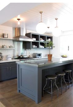 Gray cabinets // open shelves // stainless range backsplash // white subway tiles