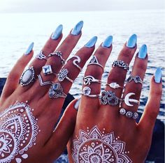 Beautiful blue nails with gorgeous white henna, accessorized perfectly! #nails #henna #boho #rings #midirings #whitehenna