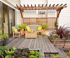 Here, a simple pergola creates gives this small garden landscaping a grand feel. Arbors and pergolas are lassic small yard landscaping odeas and great ways to frame a view, but you can do the same with shrubs, small trees, or even pieces of garden art.