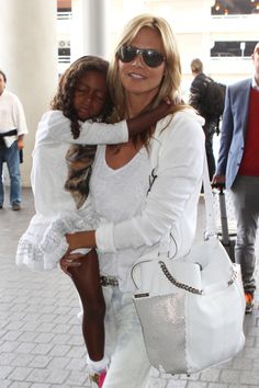Heidi Klum departs a flight at LAX Airport with her daughter Lou on May 3, 2014