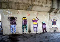 Os Gemeos, from Brazil, represent the very particular Brazilian style of graffiti. Represent 5 person arrested by the police under a viaduc. This work from Osgemeos describe cities and inhabitants.