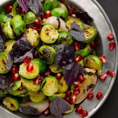 Pan-fried brussels sprouts and shallots with pomegranate & purple basil. Festive side dish, but prob tough and unnecessary to find pom molasses and purple basil.
